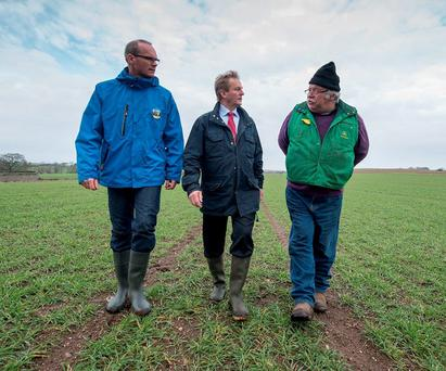 OUT AND ABOUT: Taoiseach Enda Kenny (centre) and Minister Simon Coveney visit David Richardson's cow, sheep and tillage farm in Tullow, Co Carlow, yesterday. Photo: Barry Cronin