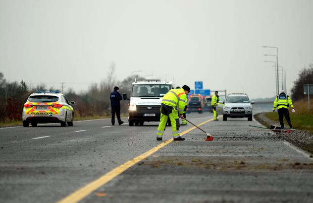 Crashed cars on back of recovery trucks being cleared from the scene Picture: Caroline Quinn