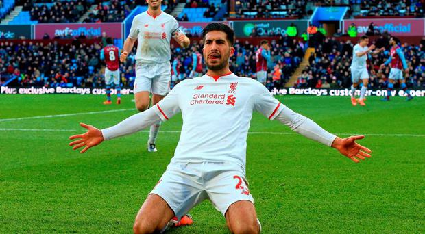 Liverpool's Emre Can celebrates scoring his side's third goal during the Barclays Premier League match at Villa Park