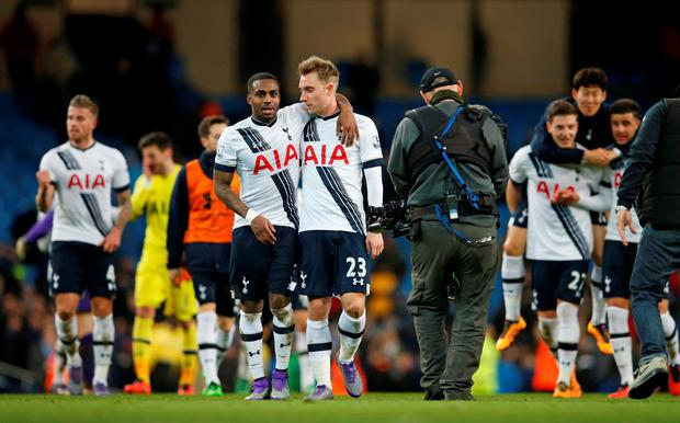Tottenham's Danny Rose and Christian Eriksen celebrate after the game