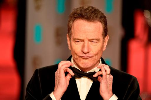 US actor Bryan Cranston poses on arrival for the BAFTA British Academy Film Awards at the Royal Opera House in London
