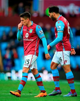 Aston Villa's Ashley Westwood (left) and Joleon Lescott look dejected during Liverpool hammering