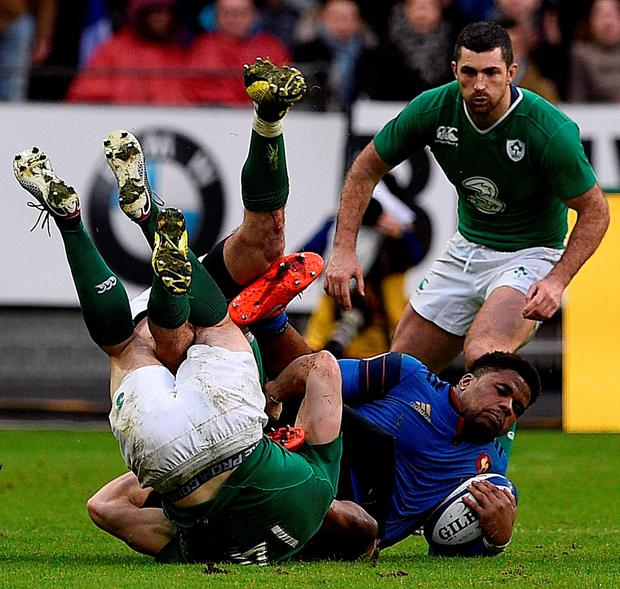 Frances inside centre Jonathan Danty (R) is tackled by Ireland's wing Andrew Trimble. Photo: Getty