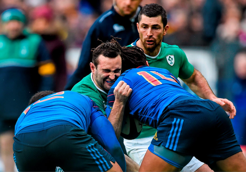 Ireland's Dave Kearney is tackled by Johnathan Danty, left, and Teddy Thomas.