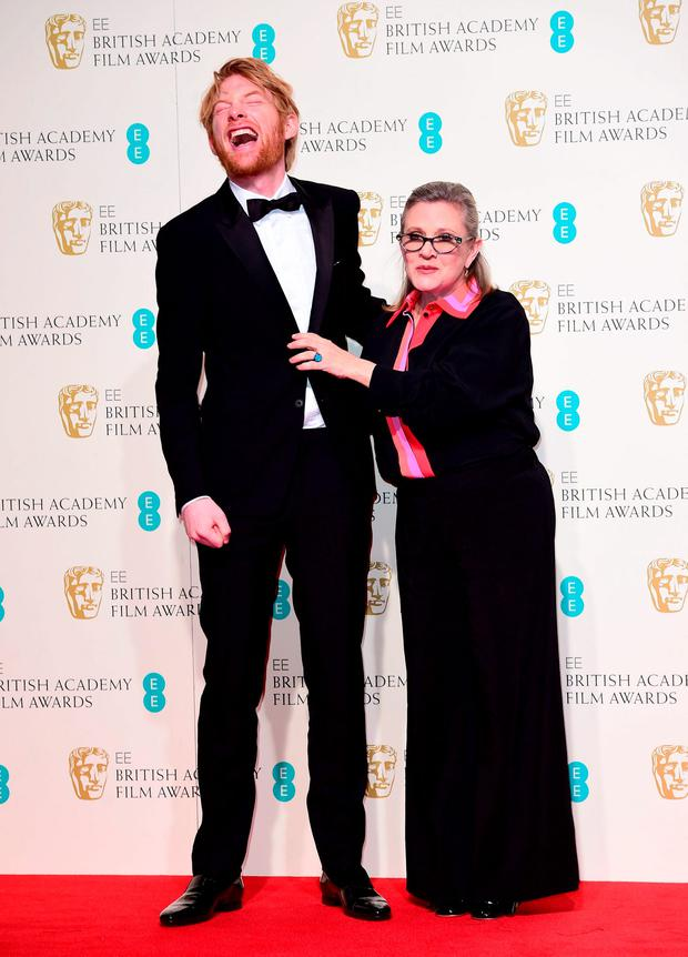 Domhnall Gleeson and Carrie Fisher in the press room at the EE British Academy Film Awards at the Royal Opera House, Bow Street, London