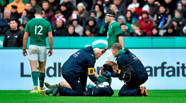 Jonathan Sexton, Ireland, receives treatment from team doctor Dr. Jim McShane, left, and team physio James Allen. Photo: Sportsfile