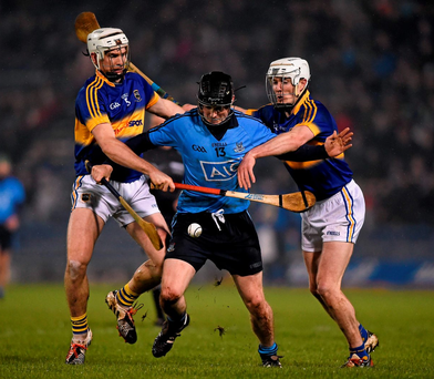 Dublin corner-forward Dotsy O'Callaghan has little room for manoeuvre as Tipperary's Brendan Maher, left, and Michael Cahill close him down during Saturday night's clash in Semple Stadium Photo: Sportsfile