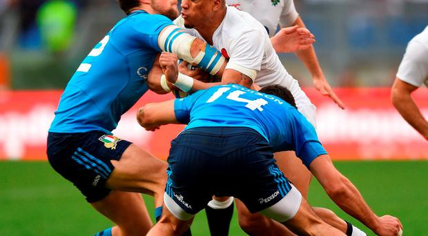 Anthony Watson of England is tackled by Edoardo Padovani and Leonardo Sarto of Italy. Photo: Getty