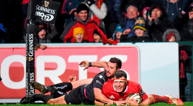 Robin Copeland goes over to score Munster's third try against Ospreys in Irish Independent Park. Photo: Sportsfile