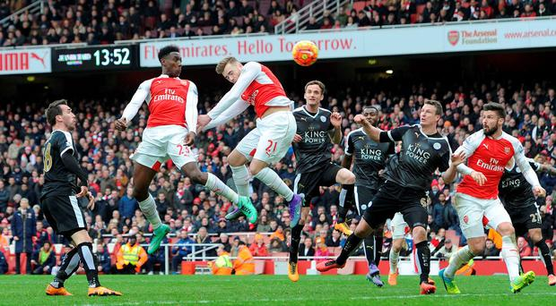 Danny Welbeck rises highest to win the game for Arsenal against Leicester. Photo: Getty