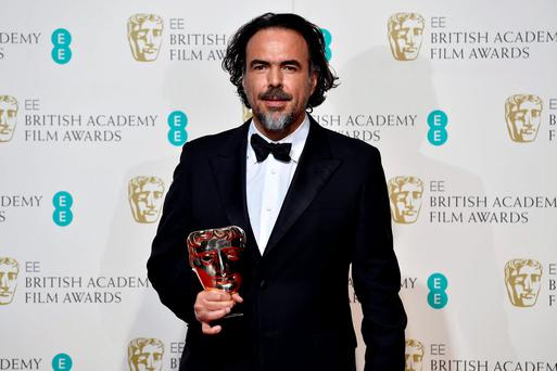 Best director Alejandro Inarritu holds his award at the British Academy of Film and Television Arts (BAFTA) Awards at the Royal Opera House in London, February 14, 2016. REUTERS/Toby Melville