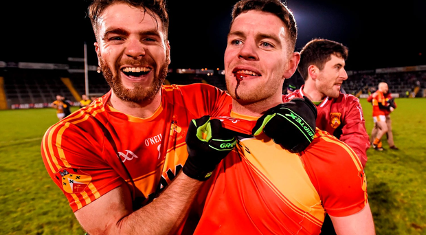 Ger McDonagh (L) and Aidan Walsh celebrate Castlebar Mitchels' win over Crossmaglen in the AIB SFC club semi-final at Kingspan Breffni Park Photo: Sportsfile