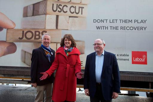 Joan Burton with candidates Kevin Humphries (left) and Eric Byrne at the launch of Labour's new mobile hoarding. Photo: RollingNews.ie