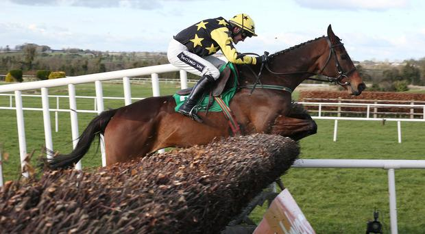 Sambremont ridden by Ruby Walsh jumping the last fence in the flyingbolt novice steeplechase Photo: Caroline Norris