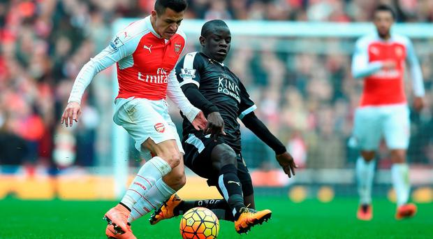 N'golo Kante challenges Arsenal's Alexis Sanchez for possession . Photo: Getty