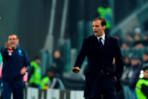 With his Napoli counterpart Maurizio Sarri in the background, Juventus coach Massimiliano Allegri barks out the orders during Saturday's showdown Photo: Getty