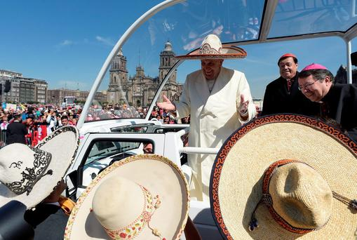Pope Francis wears a traditional Mexican sombrero as he greets his supporters in Mexico City. Photo: AP