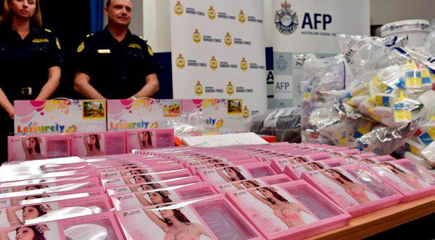 Gel bra inserts (foreground L) containing concealed crystal methamphetamine seen at the Australian Federal Police headquarters in Sydney on February 15, 2016 AFP/Getty Images