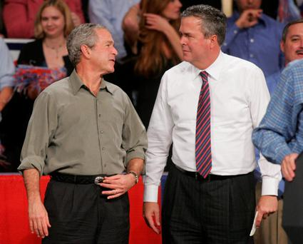 Former President George W. Bush jokes with his brother Florida Governor Jeb Bush in Pensacola, Florida.(AP Photo/Mari Darr-Welch, File)