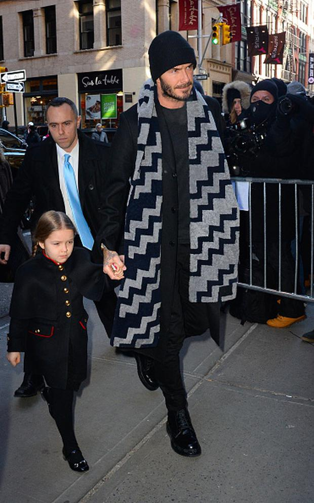 David Beckham and Harper Beckham are seen arriving at Balthazar Restaurant in Soho on February 14, 2016 in New York City. (Photo by Raymond Hall/GC Images)