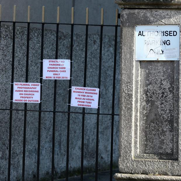 Signs on the gate of the church on St Francis Street today