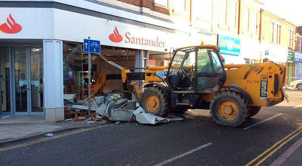 The scene at the Santander bank in Leighton Buzzard Photo: @neilbradfordtv/BBC/Twitter