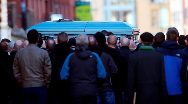 The coffin is carried into St Nicholas of Myra church on Francis Street in Dublin, during the funeral of David Byrne. Photo: PA