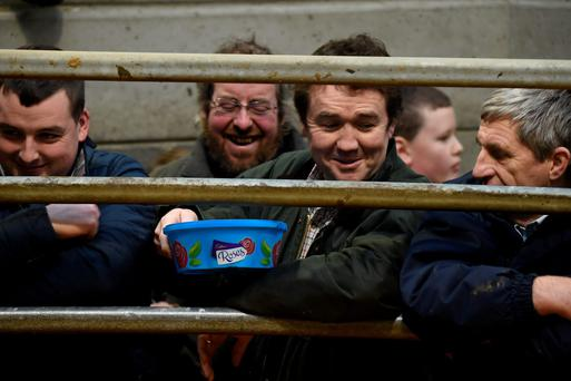 The sweets are passed around at a recent sale in Carnew Mart. Photo: Roger Jones.