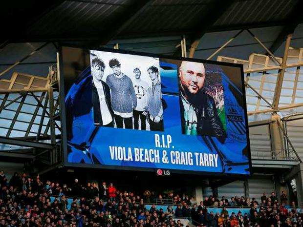 General view during a minutes applause for Viola Beach and Craig Tarry, who had been a Manchester City supporter, during the Manchester City v Tottenham Hotspur match