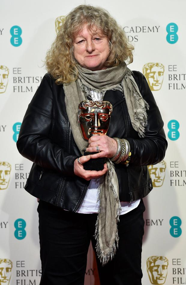 Jenny Beavan poses after winning the award for best costume at the British Academy of Film and Television Arts (BAFTA) Awards at the Royal Opera House in London, February 14, 2016. REUTERS/Toby Melville
