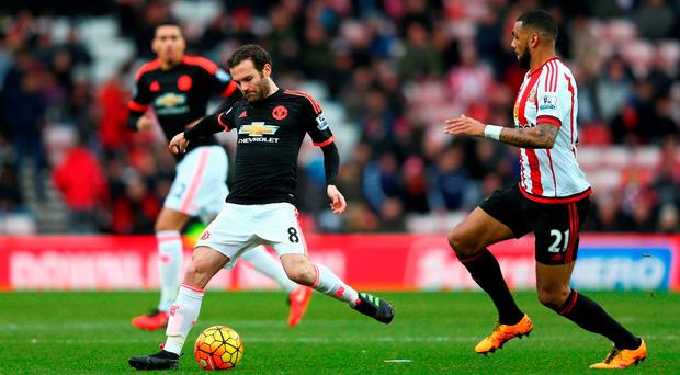 Juan Mata of Manchester United passes the ball during the Barclays Premier League match between Sunderland and Manchester United at the Stadium of Light on February 13, 2016 in Sunderland, England. (Photo by Clive Brunskill/Getty Images)