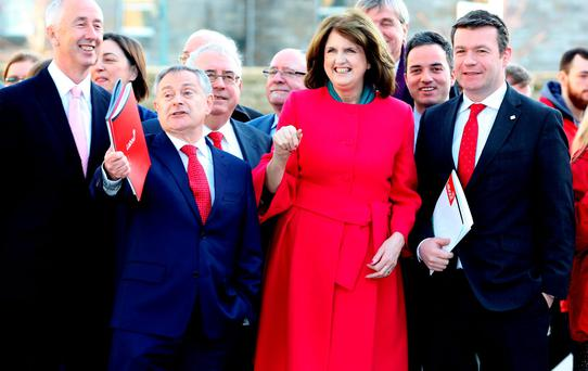 Tánaiste Joan Burton with ministers Brendan Howlin and Alan Kelly at the launch of the Labour Party Election Manifesto at DIT Grangegorman yesterday. Photo: Tom Burke