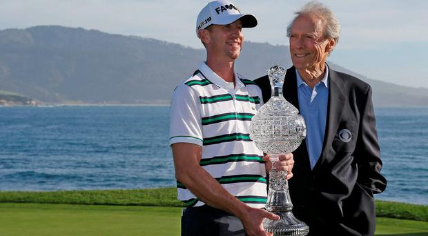 Vaughn Taylor, left, with Clint Eastwoodon the 18th green at Pebble Beach after his victory in the AT&T National. Photo: AP