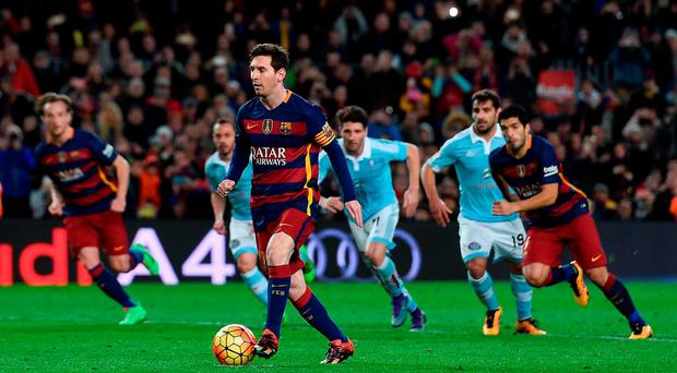 Messi passes the ball from the penalty spot for Suarez to score against Celta Vigo on Sunday, however the pass was meant for Neymar. Photo: Josep Lago/AFP/Getty Images