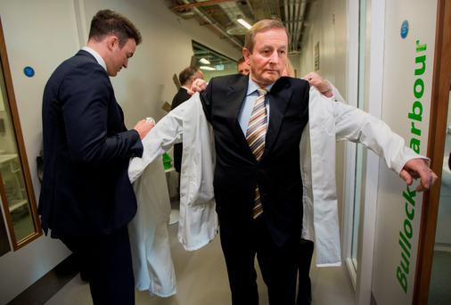 Taoiseach Enda Kenny gets ready to enter one of the labs at APC Ltd as the company opened its new state of the art process research facility in Cherrywood, Dublin. Photo: Fergal Phillips