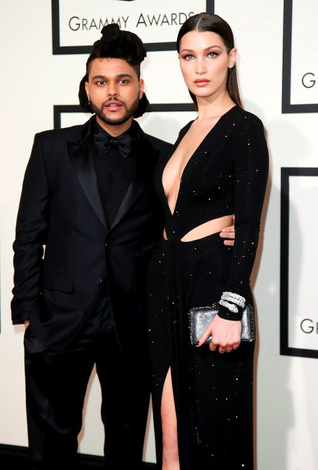 The Weeknd and Bella Hadid arrive at the 58th Grammy Awards in Los Angeles, California February 15, 2016. REUTERS/Danny Moloshok