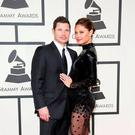 Nick Lachey and his wife Vanessa arrive at the 58th Grammy Awards in Los Angeles, California February 15, 2016. REUTERS/Danny Moloshok
