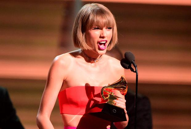 Singer Taylor Swift accepts the award for the Album of the Year onstage during the 58th Annual Grammy music Awards in Los Angeles