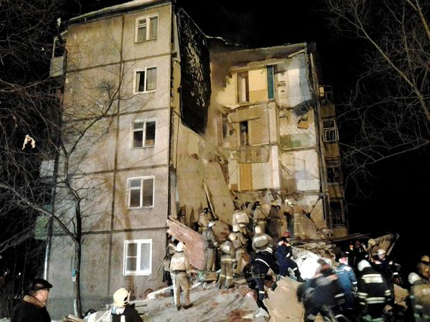 In this photo provided by the Yaroslavl Branch of Russian Emergency Ministry Press Service, emergency and rescue workers search the debris of a 5-story apartment building after a powerful natural gas explosion early Tuesday, Feb. 16, 2016, in Yaroslavl, Russia