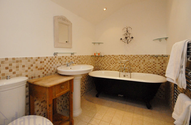 The bathroom is the perfect place to unwind. Photo: Daft.