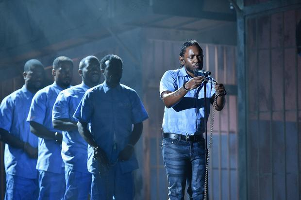 Rapper Kendrick Lamar (C) performs onstage in chains during The 58th GRAMMY AwardS. (Photo by Kevork Djansezian/Getty Images for NARAS)