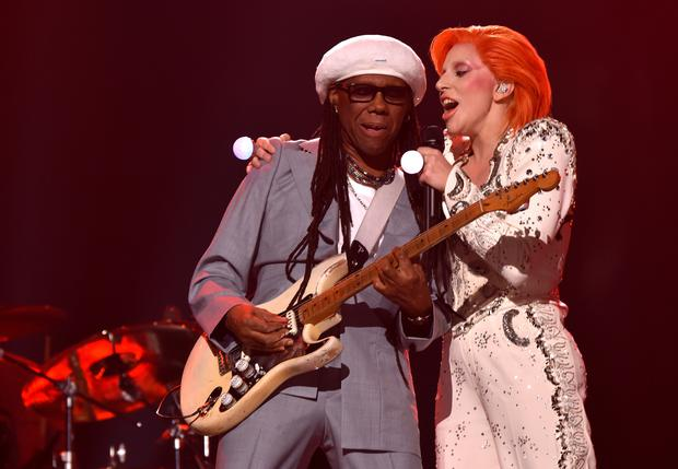 Musician/producer Nile Rodgers (L) and singer Lady Gaga perform a tribute to the late David Bowie onstage during The 58th GRAMMY Awards. (Photo by Larry Busacca/Getty Images for NARAS)