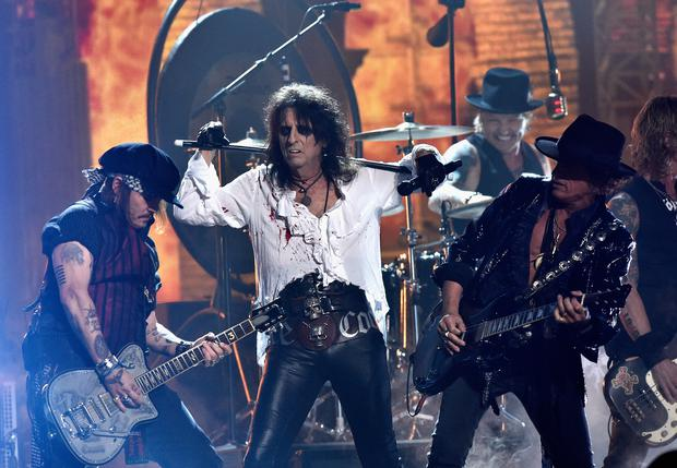 (L-R) Actor/musician Johnny Depp, singer Alice Cooper and musician Joe Perry of Hollywood Vampires perform onstage during The 58th GRAMMY Awards at Staples Center on February 15, 2016 in Los Angeles, California. (Photo by Kevork Djansezian/Getty Images for NARAS)