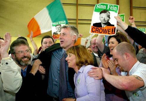 Sinn Fein's Sean Crowe (C) hugs his wife Pamela