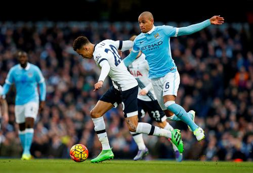 Tottenham's Dele Alli in tackled by Manchester City's Fernando on Sunday. Photo: Reuters.