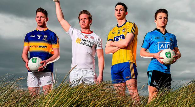 Jimmy Feehan (Tipperary), Frank Burns (Tyrone), Cathal Compton (Roscommon) and Eoin Murchan (Dublin) on Dollymount Strand after the launch of the EirGrid U-21 All-Ireland Football Championship (SPORTSFILE)