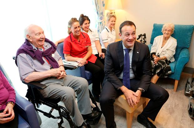 Health Minister Leo Varadkar takes time out from canvassing to open Ardmore Lodge and meet residents and staff of the nursing home including, (left to right) Nodlaig O Cianain, Sharon Hyland, activities co-ordinator, healthcare assistants Chloe Dunne and Gina Creighton, and Gabriel Smyth. Photo: Maxwells