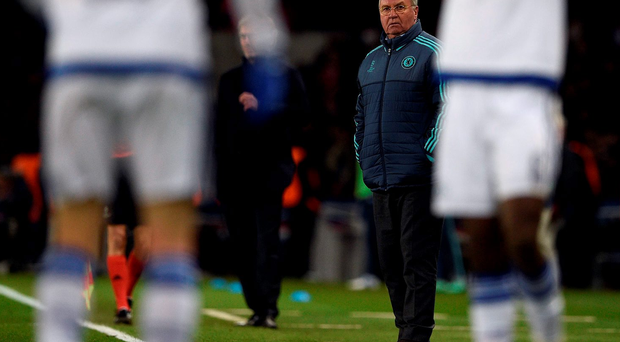 Chelsea's Dutch coach Guus Hiddink watches his players during the Champions League round of 16 first leg football match between Paris Saint-Germain. AFP PHOTO