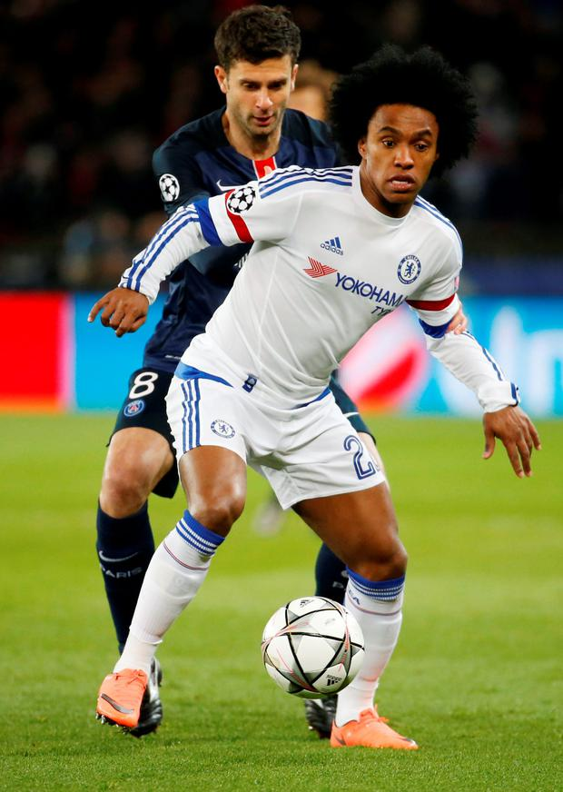 Paris St Germain's Thiago Motta harries Chelsea's Willian. Photo: Gonzalo Fuentes/ Reuters.