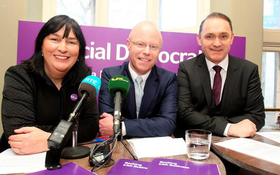Stephen Donnelly,TD,the Social Democrat co-leader (centre) pictured with candidates Glenna Lynch, Dublin Bay South and Liam Coyne, Dublin South-Central at the launch of the Social Democrats 'Backing Irish Business' policy which is part of their election manifesto at the Whiskey Museum,Grafton Street. Pic Tom Burke